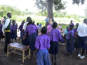My Granddaughter Interacting with School Children Near Gulu, Uganda