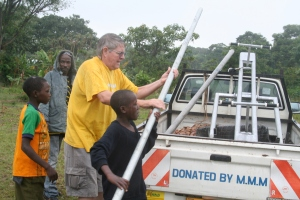 Helping to Unload a Seesaw in Southern Uganda