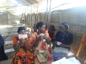 Ugandan Women's Group Getting a Micro-loan from a Utah NGO (Interethnic Health Alliance)