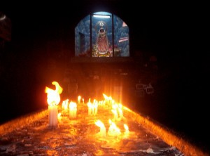 The Copabana, Bolivia, Candle Table with Black Virgin Icon in the Background