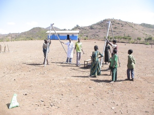 Starting to Erect a Swing Set in Ethiopia