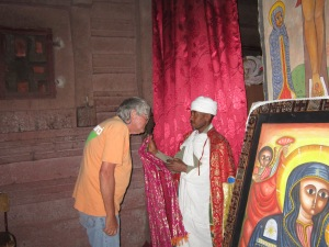 The Author Getting a Blessing From an Ethiopian Orthodox Priest (I'm not Really This Fat, I Have My Passport Under My T-shirt)