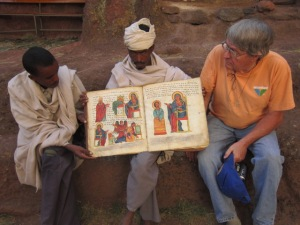 Priest and Local Guide Showing Off Their Ancient Manuscript