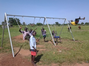 Children Swinging at a School for the Deaf, Lira, Uganda