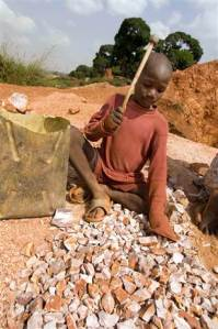 Nine-year Old Boy Chipping Rocks Near Kampala, Uganda