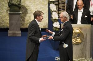 Lars Receiving His Nobel Prize from the King of Sweden