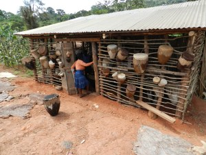 Drum Store with Hides Outside Being Dried