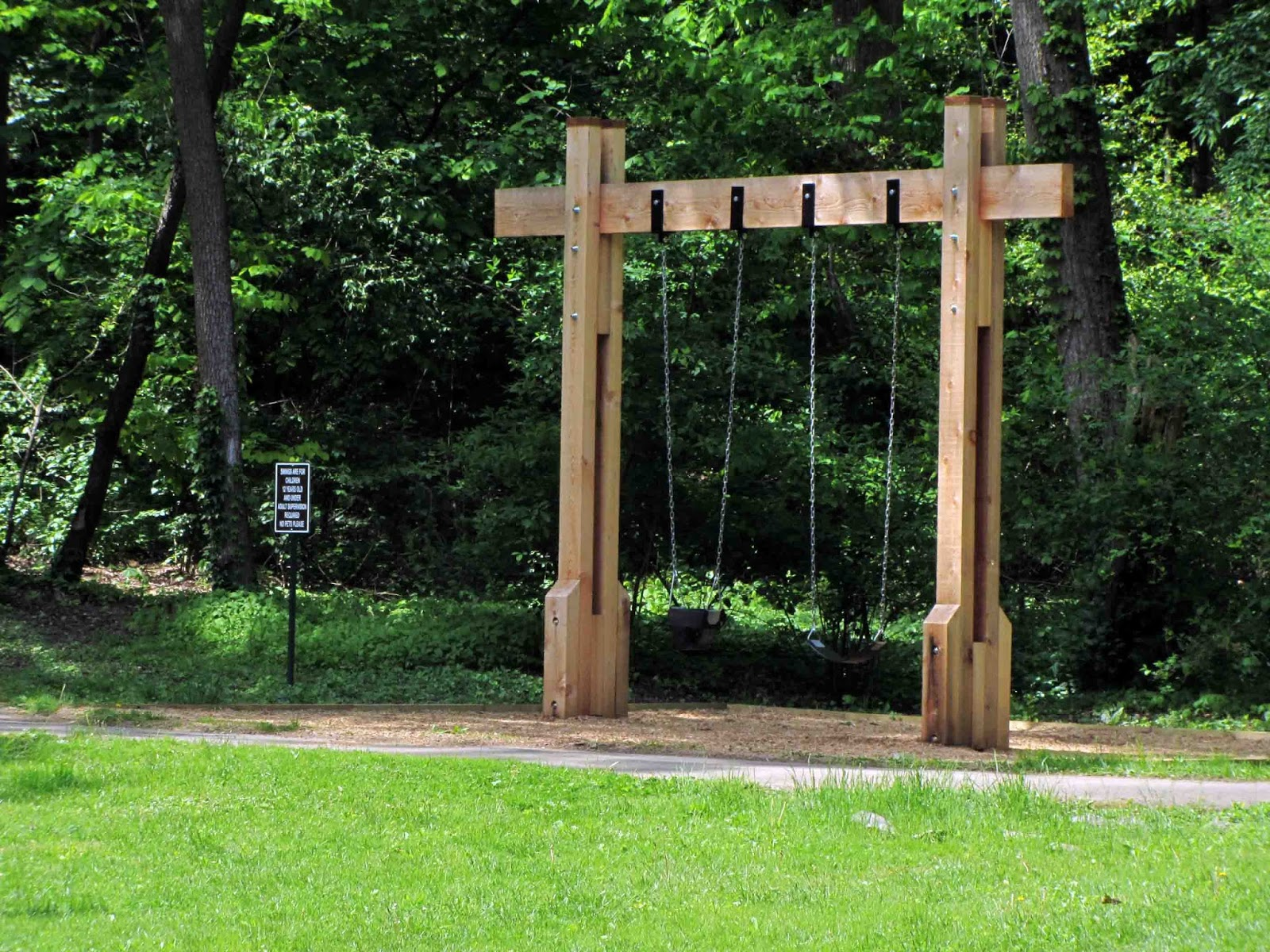 Designs for wooden swing sets tired road warrior for Log swing plans