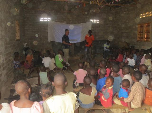 NASA Scientist Michael Flynn Talking to Students in Uganda