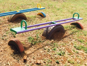 This Metal Ugandan Seesaw is Mounted on a Tire