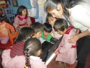 Preschool Huddled Around the Newly Arrived Laptop Computer