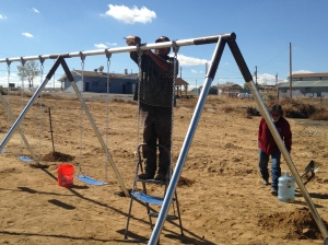 Installing a Swing Set near the Becenti Chapter House in Western NM