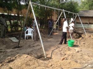 Installing a Swing Set in the Village of Kyarumba