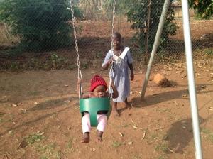 Enjoying the Swing Set at the Lira Baby Orphanage