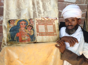 Ethiopian Priest Showing Off an Old Goat-Skin Illustrated Book