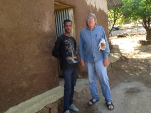 My Guide and Asnake Discussing the Needs of Awra Amba Community