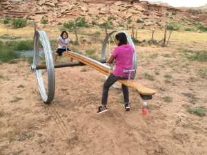 Enjoying the Irrigation-Wheel Teeter Totter at the Bluff Mission