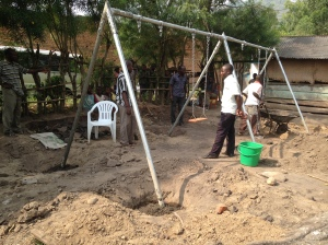Installing a Swing Set at a School in Kyarumba, Uganda