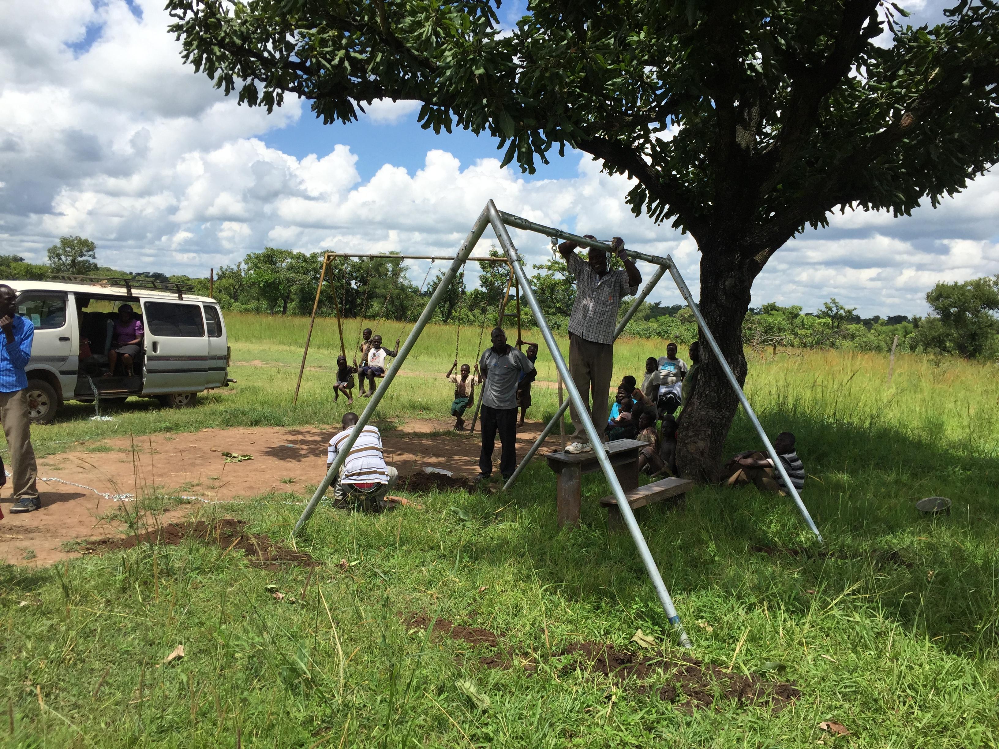 Installing swing sets in the gulu uganda area tired for Swingvillage