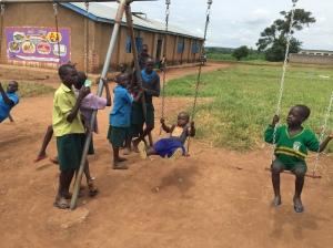 Enjoying the Swing Set at Nancy School for the Deaf in Lira, Uganda