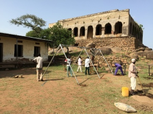 Installing Swing Set at Hirai Islamic Primary School, with Mosque in the Background