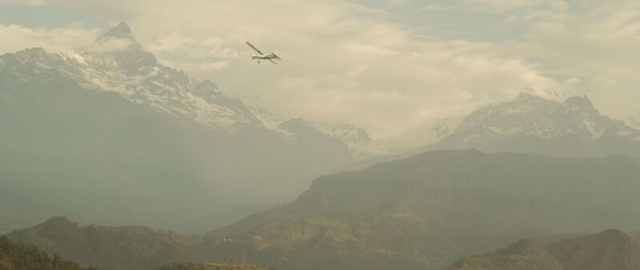 Snow-capped Himalayas Dwarf a Local Commuter Plane