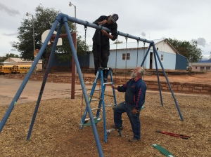 Making Repairs to an Existing Swing Set at Mission School