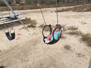 Navajo Baby Enjoying Tire Swing Seat