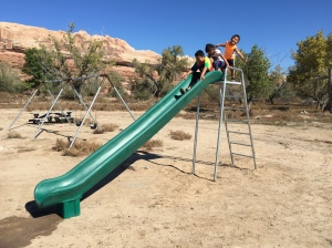 Kids Using the Rocket Slide Installed near Bluff, UT