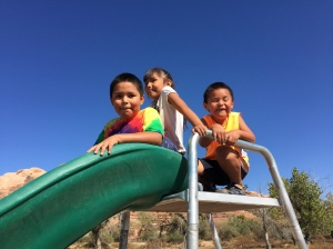 Navajo Kids Enjoying Their New Rocket Slide