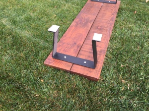 Metal Legs Are Attached to the Hatch Board to Convert It to a Bench