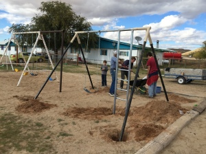 Combination Swing-and-Slide Set Being Installed at Preschool