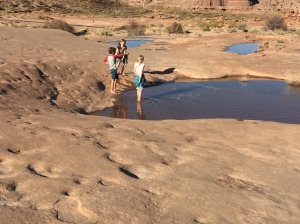 My Grandchildren Enjoying the Potholes in the Northern Navajo Nation