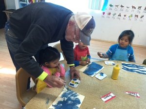 Roe Assisting the Preschoolers with Their Artistic Endeavors