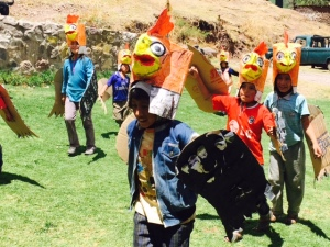 Peruvian Children Performing a Condor Dance after a Playground Installation