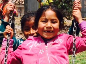 Children Enjoying a Swing