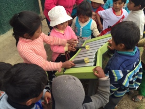 Young Quechua Children Enjoying Their New Playground Activity