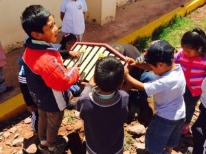Peruvian Children Enjoying Their Musical Instrument