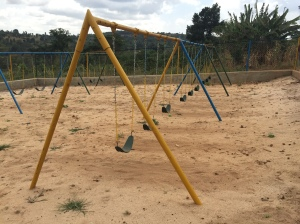"Nine-seat Swing Set at ""Raising the Roof"" Academy near Masaka, Uganda"
