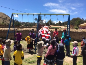 Santa (aka Willow C-T) Enjoying the School's Playground Equipment
