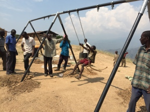Village Children Testing Out the Swing Set